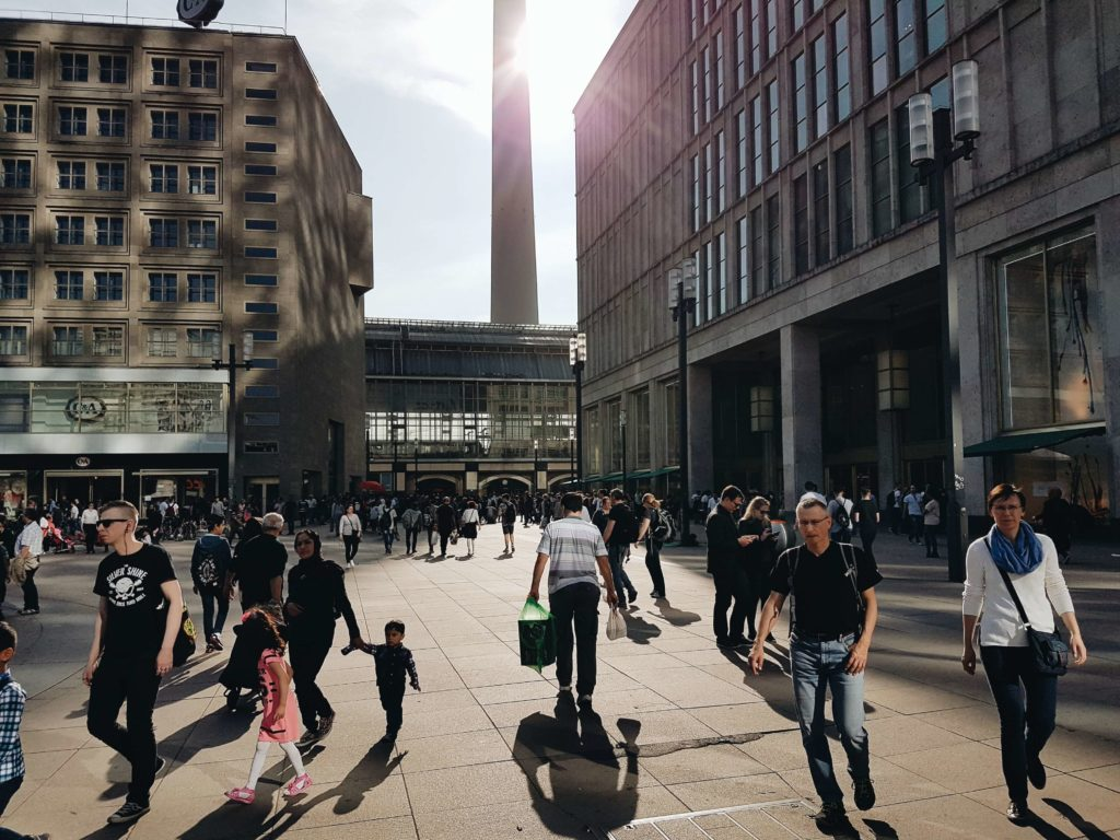 Alexanderplatz and many people walking on the street