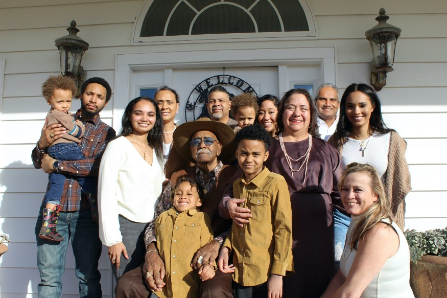a big family in front of a house